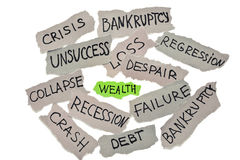 Wealth in business  concept. Faded peaces of paper with ''bankruptcy'', loss, crisis, failure etc. inscriptions surrounded green paper with wealth word Stock Photography