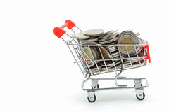 Wealth coins shopping cart Stock Images