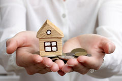 Wealth in hands. Man holds in hands money with a home Royalty Free Stock Photos