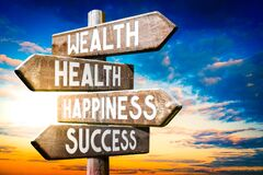 Free Wealth, Health, Happiness, Success - Wooden Signpost, Roadsign With Four Arrows Stock Photos - 190910213