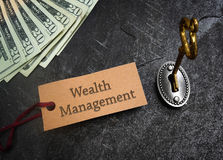 Wealth Management concept. Wealth Management tag and gold key with cash Royalty Free Stock Images