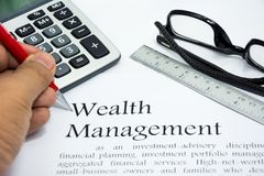Wealth management text of business concept Stock Images