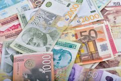 Wealth - scattered money, different currencies Royalty Free Stock Image