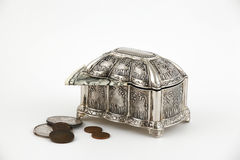 Wealth. Silver Casket and money on white background Royalty Free Stock Photo
