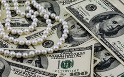 Wealth, US dollars and real pearls Stock Photography