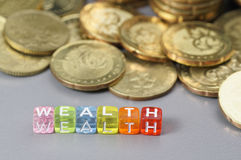 Wealth word on dice Stock Photo