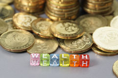 Wealth word on dice Stock Image