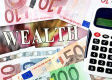 Wealth word with money Royalty Free Stock Image