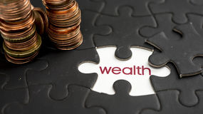 Wealth. Word wealth under jigsaw puzzle piece Stock Photo