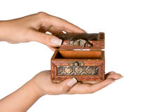Wealth in your hand. Hand holding a small treasure chest Stock Image