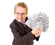 Wealthy boy. Portrait of happy boy with dollar bills looking at camera Stock Photography
