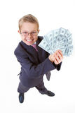 Wealthy boy. Portrait of happy boy with dollar bills looking at camera Stock Image