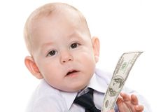 Wealthy boy. Portrait of serious baby boy with dollar banknote looking at camera Stock Photos