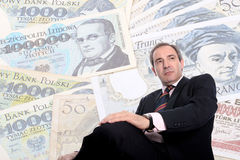 Wealthy Business man. Over money bills background stock photography