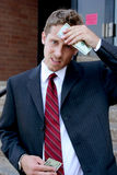 Wealthy Businessman. Businessman wiping sweat from forehead with a twenty dollar bill Stock Photos