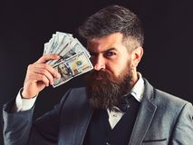 Wealthy and confident. Bearded man with dollar banknotes. Successful businessman hold cash money. Rich man with beard in. Formal wear. Business and finance royalty free stock images