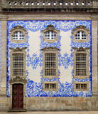 Wealthy house facade in Porto, Portugal. The facade is covered with antique tiles (azulejo). The azulejo are painted ceramic and constitute a major aspect of Stock Photo