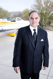 Wealthy industrialist with his private plane Royalty Free Stock Photography