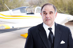 Wealthy industrialist with his private plane Stock Photography