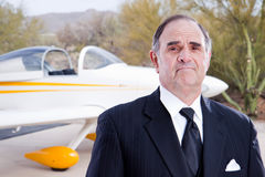 Wealthy industrialist with his private plane Stock Images