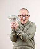 Wealthy man holding group of twenty dollar bill. Lucky, wealthy man excitedly holding group of twenty dollar bills Royalty Free Stock Photos