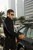 A wealthy man locking his car Stock Photo