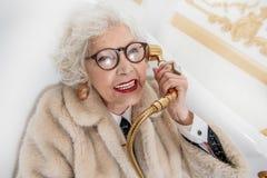Wealthy old lady having fun in bathroom Stock Photos