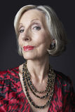 Wealthy Senior Woman Wearing Necklace Stock Photos