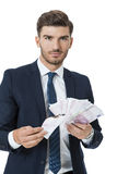 Wealthy successful businessman burning money Royalty Free Stock Image