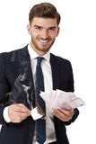 Wealthy successful businessman burning money Stock Photo