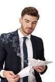 Wealthy successful businessman burning money Royalty Free Stock Photography