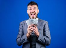 Wealthy and successful. Making money with his own business. Business startup loan. Bearded man holding cash money. Rich. Businessman with us dollars banknotes royalty free stock image