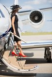 Wealthy Woman Disembarking Private Jet Royalty Free Stock Photos