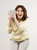 Wealthy woman holding group of twenty dollar bi royalty free stock photography
