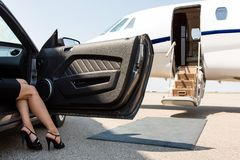 Wealthy Woman Stepping Out Of Car At Terminal royalty free stock photo