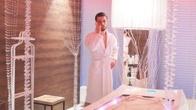 Wealthy young man resting in a luxurious Spa. Man waiting for start of procedure. stock video