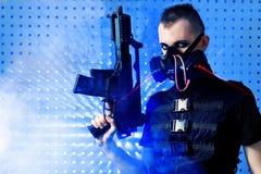 Weapon. Shot of a conceptual man in a respirator holding a gun royalty free stock image