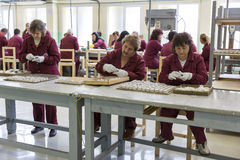 Weapon arms arsenal production workers detonators. Sopot, Bulgaria - May 17, 2016: Arsenal women workers are producing weapons detonators in one of Bulgaria's Stock Image