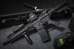 Weapon assault rifle. Assault rifle AR15 and flashlight Stock Image