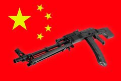 Weapon - Assault rifle China of a flag background Royalty Free Stock Photography