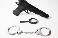 Weapon Crime Concept Gun and Handcuffs Royalty Free Stock Photos