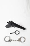 Weapon Crime Concept Gun and Handcuffs Royalty Free Stock Photography