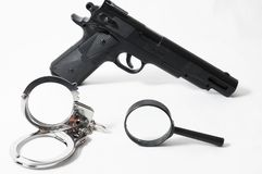 Weapon Crime Concept Gun and Handcuffs Stock Images