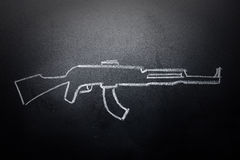 Weapon draw erased on blackboard - no violence concept.  Royalty Free Stock Photo