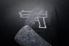 Weapon draw erased on blackboard - no violence concept. Idea stock photos