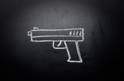 Weapon draw erased on blackboard - no violence concept. Idea royalty free stock images