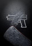 Weapon draw erased on blackboard - no violence concept. Idea royalty free stock image