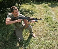 Weapon and man. Aggression man portrait with kalashnikov Royalty Free Stock Images