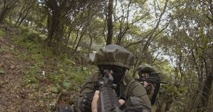 Weapon GoPro POV footage of a squad of Israeli commando soldiers during combat. Weapon POV footage of an Israeli army soldier squad during combat stock video