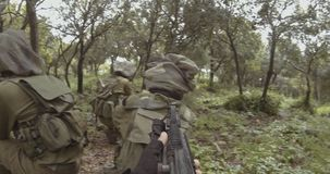 Weapon GoPro POV footage of a squad of Israeli commando soldiers during combat. Weapon POV footage of an Israeli army soldier squad during combat stock footage